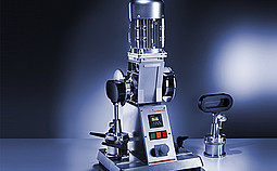 Two-place grease working machine with stroke counter.