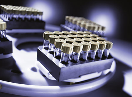 Silicon carbide block of Rotor 4x24MG5 with 24 disposable glass vials arranged in ANSI format.